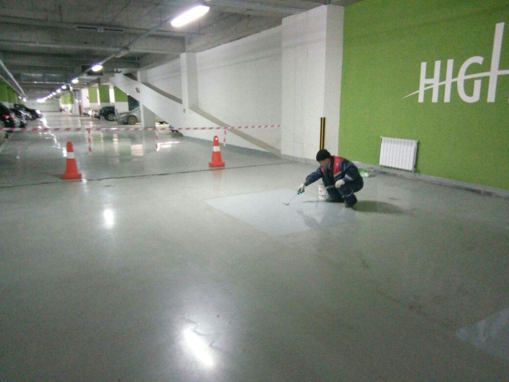 Разметка функциональных зон в действующем паркинге на Нагатинской